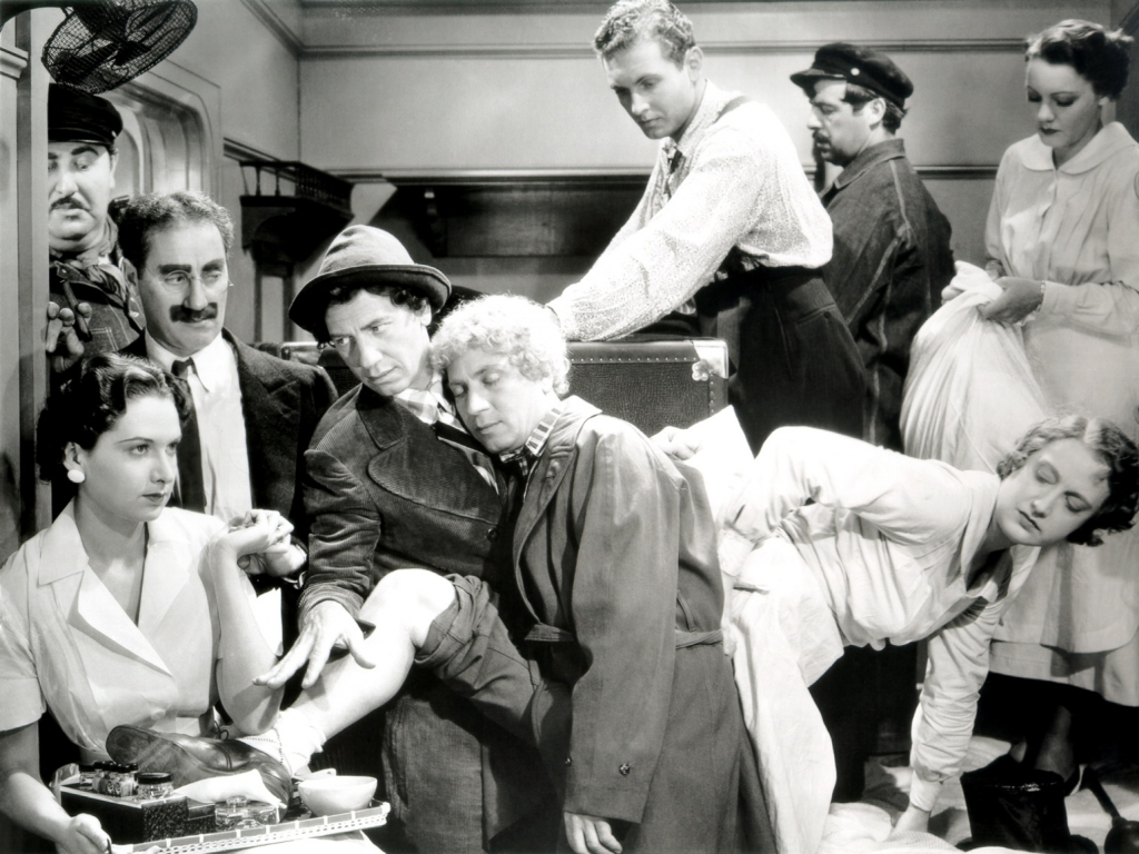 "Groucho, Chico, and Harpo Marx w/ cast in the stateroom scene from ""A Night at the Opera"" (1935)"